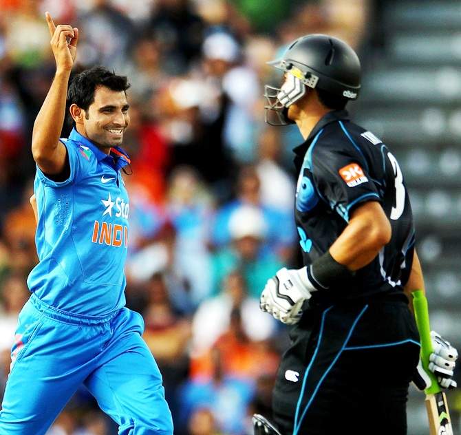 Mohammed Shami of India celebrates after taking the wicket of Ross Taylor