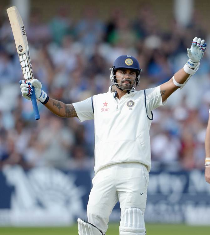 Murali Vijay celebrates after scoring a hundred on Day 1