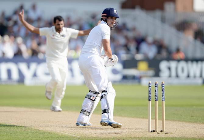 India pacer Mohammad Shami celebrates after bowling England captain Alastair Cook