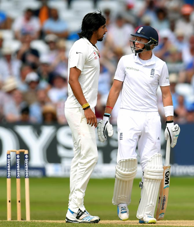 Ishant Sharma (left) exchanges a few words with Joe Root