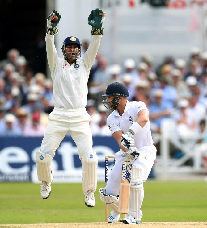 India captain Mahendra Singh Dhoni appeals successfully for the wicket of England batsman Matt Prior off the bowling of Bhuvneshwar Kumar