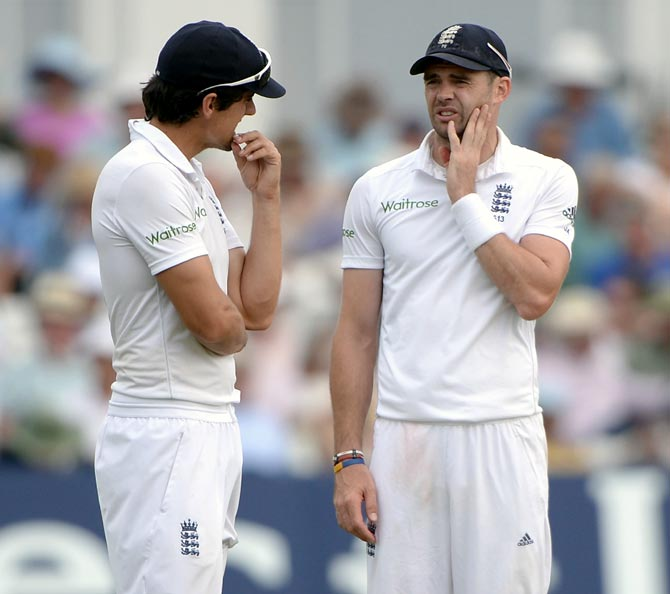 James Anderson (right) speaks to England captain Alastair Cook