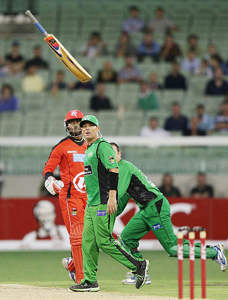 Marlon Samuels of the Melbourne Renegades throws his bat in front of Shane Warne of the Melbourne Stars in a heated exchange with during their Big Bash League match