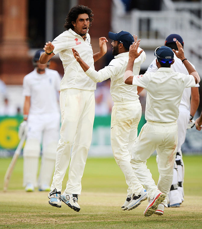India's Ishant Sharma celebrates dismissing England captain Alastair Cook
