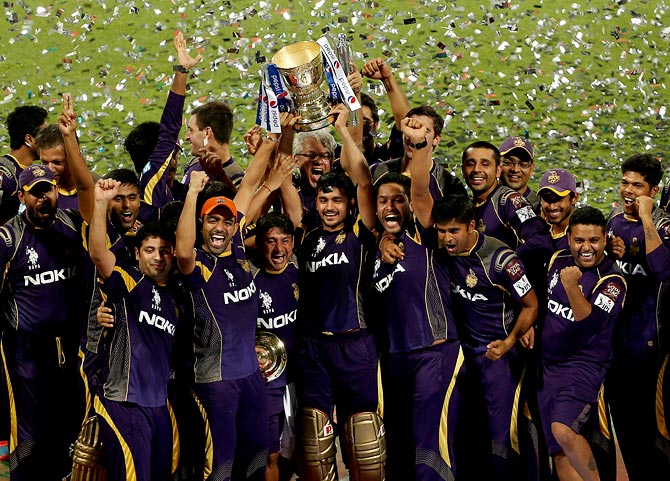 Kolkata Knight Riders players celebrate with the IPL trophy