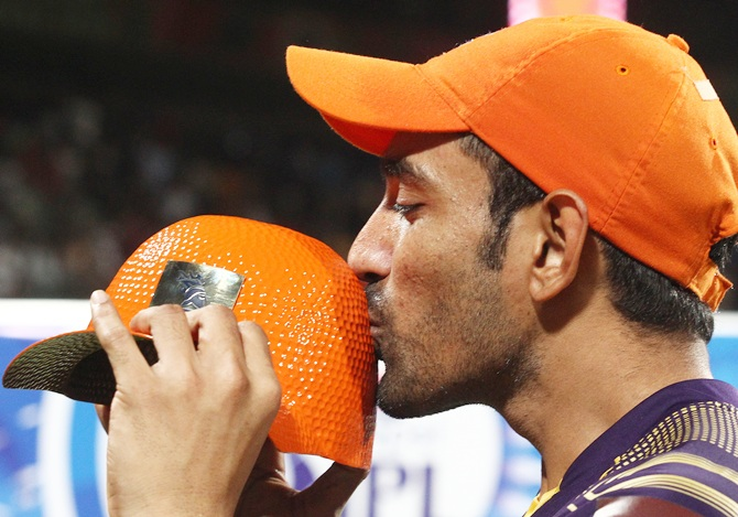 Robin Uthappa with the Orange cap, awarded to the highest scorer in the IPL