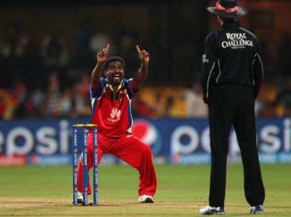 Muttiah Muralitharan appeals for a wicket during an Indian Premier League match