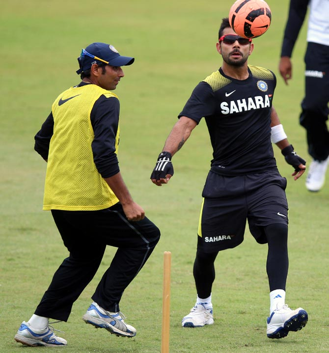 Virat Kohli (right) and Mohammed Shami play football during a practice session