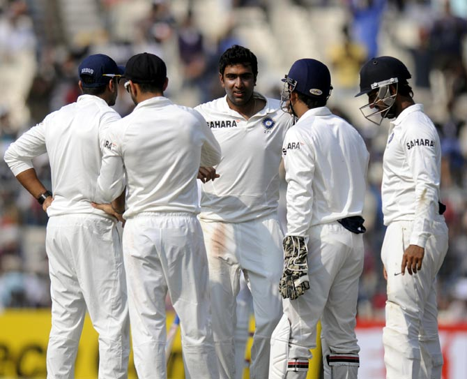 R Ashwin (centre) celebrates a wicket with his team mates