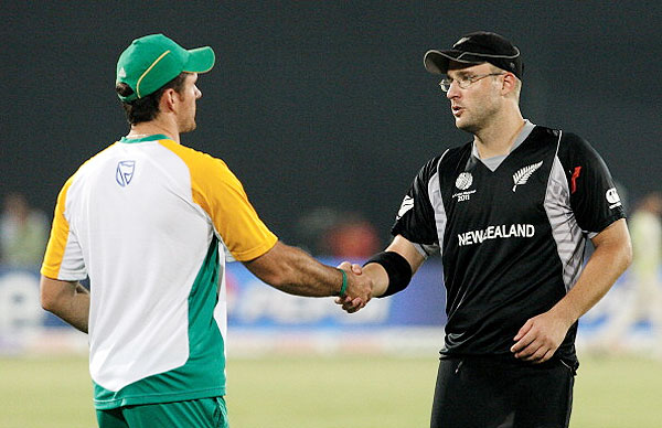Graeme Smith of South Africa (left) shakes hands with Daniel Vettori of New Zealand after their 2011 ICC World Cup quarter-final at Shere-e-Bangla National Stadium on March 25, 2011 in Dhaka