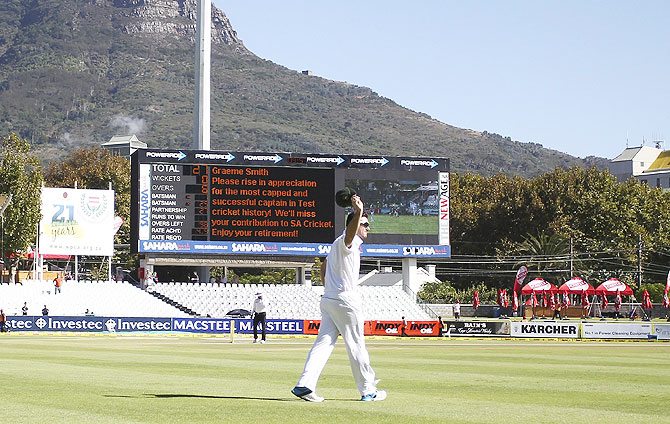 South Africa's captain Graeme Smith acknowledges the spectators after announcing his retirement during the fourth day of the third Test against Australia at Newlands Stadium in Cape Town on Monday