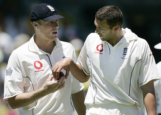 England's Andrew Flintoff (left) has a word with pace bowler Steve Harmison