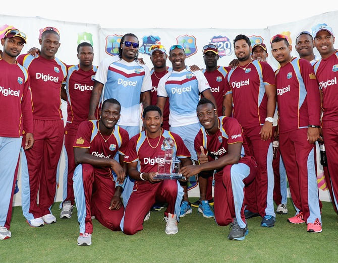 The West Indies celebrate after winning the T20 International series against England at Kensington