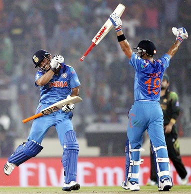 Virat Kohli (right) and Suresh Raina celebrate after overhauling Pakistan's total