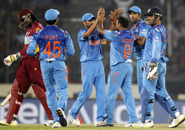 West Indies' Chris Gayle, left, leaves the field as India's fielders celebrate his dismissal during their ICC Twenty20 World Cup match at the Sher-E-Bangla National Stadium