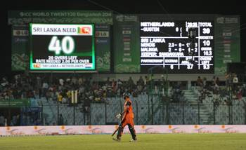Ahsan Malik of the Netherlands leaves the field after his team was bowled out for 39 runs in the ICC World Twenty20 Bangladesh 2014 Group 1 match against Sri Lanka at the Zahur Ahmed Chowdhury Stadium.