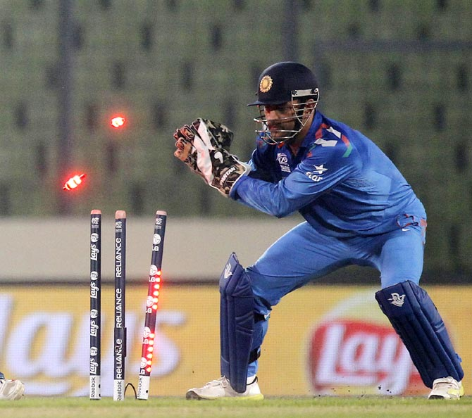 India captain Mahendra Singh Dhoni whips off the bails to effect a stumping during the World T20.