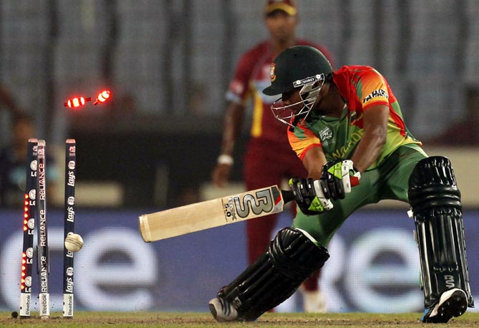 Bangladesh's Sohag Gazi is bowled during the match against West Indies in the World T20.