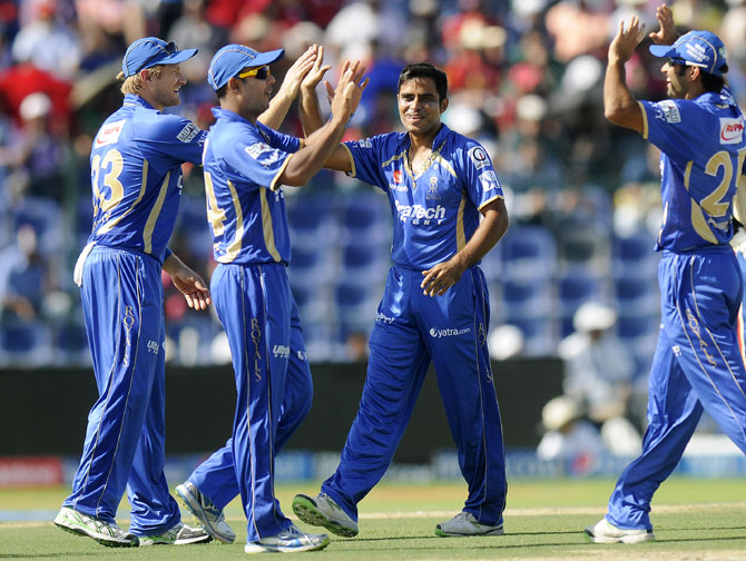 Rajat Bhatia is congratulated by Rajasthan teammates after taking a wicket