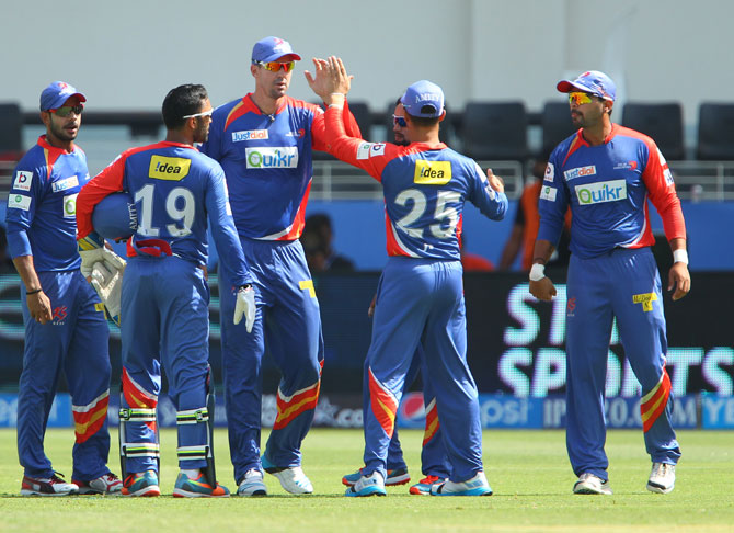Delhi Daredevils celebrate the fall of a wicket
