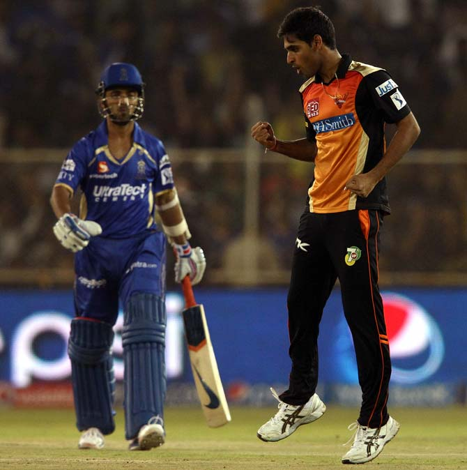 Bhuvneshwar Kumar celebrates the wicket of Ajinkya Rahane
