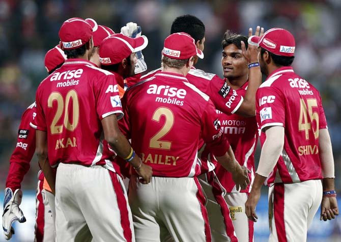 Kings XI Punjab players celebrate after Sandeep Sharma took the wicket of Murali Vijay