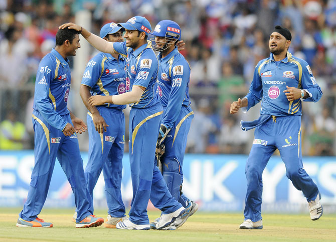 Mumbai Indians players celebrate a wicket.