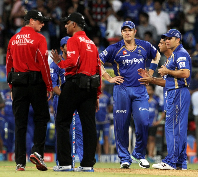 Rajasthan Royals players and the umpires discuss the run-rate calculations.