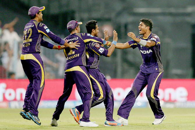Umesh Yadav is congratulated by his Kolkata Knight Riders' teammates after taking a wicket
