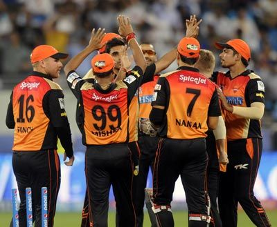 Bhuvneshwar Kumar is congratulated by his Sunrisers teamates after the wicket of Rohit Sharma