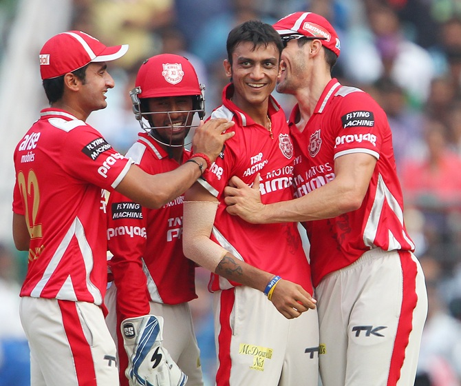 Akshar Patel, centre, celebrates