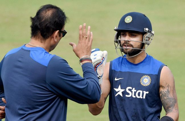 Virat Kohli, right, speaks to Ravi Shastri. Photograph: PTI