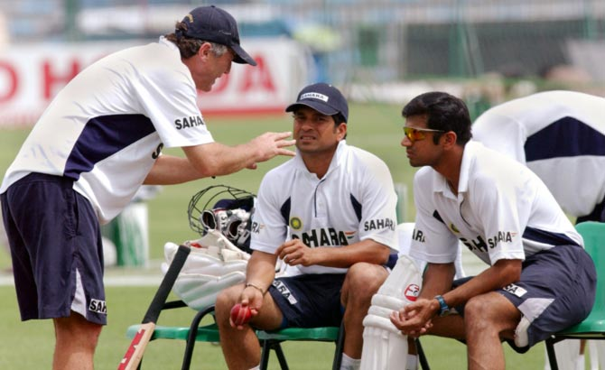 India's then coach John Wright, left, speaks to Rahul Dravid, right, and Sachin Tendulkar during the tour to Pakistan in 2004. Photograph: Reuters
