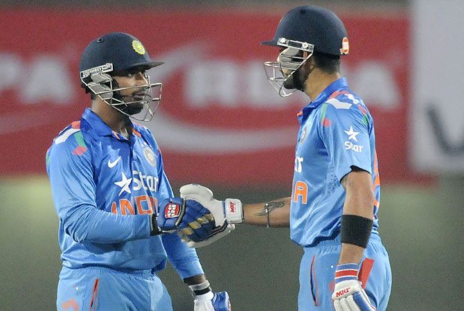 Ambati Rayudu of India is congratulated by his captain Virat Kohli after completing his half century in Ranchi