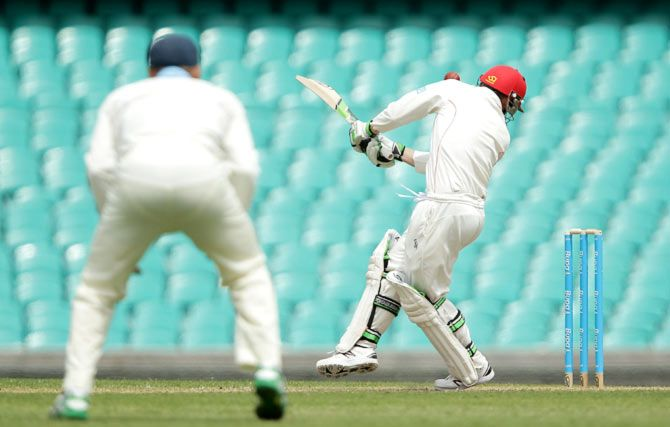 Phillip Hughes of South Australia is struck in the head by a short delivery