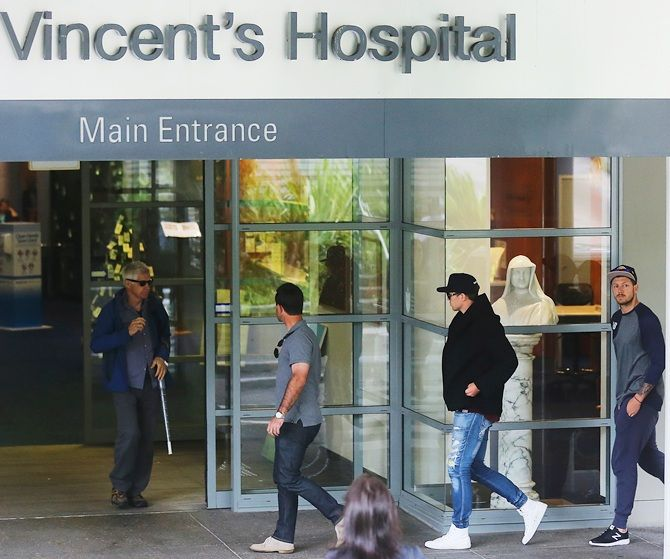 Ricky Ponting, Peter Siddle and James Pattinson arrive at St Vincent's Hospital