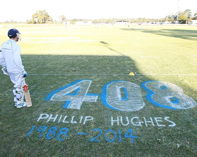 A batsman for Langwarrin U/16 waits to bat in a match played against Mount Eliza, and was   dedicated to Phil Hughes, at Lloyd Park in Langwarrin