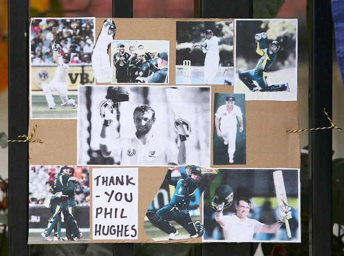 Tributes to Phillip Hughes are seen outside the ground at the WACA