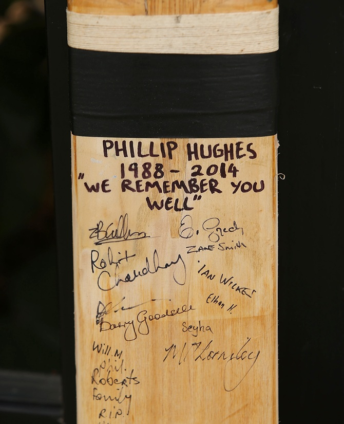 A cricket bat with signatures which as been placed as a tribute to Phillip Hughes is seen   outside the ground at the WACA