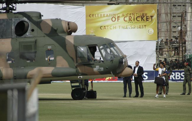 Sri Lanka's cricket team members prepare to board a Pakistani military helicopter at the Gaddafi stadium in Lahore after their team bus was attacked by gunmen in March 2008