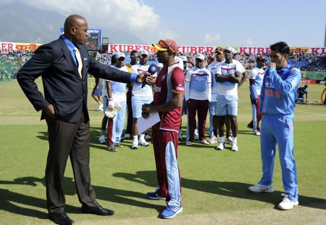 West Indies skipper Dwayne Bravo speaks to Ian Bishop at the toss on Friday