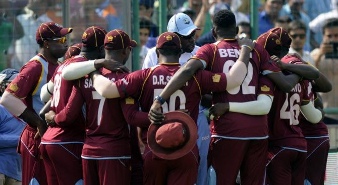 The West Indies players in a huddle before the start of the second ODI against India in New Delhi