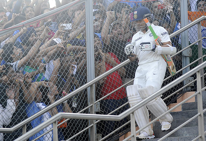 Sachin Tendulkar walks out to bat in his final Test match at the Wankhede