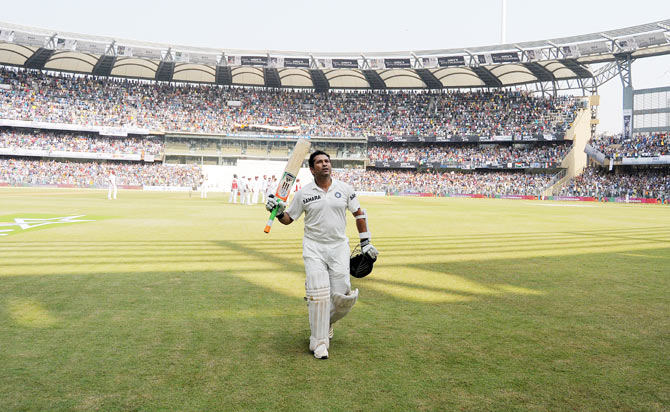 Sachin Tendulkar acknowledges the crowd as he walks back after his dismissal