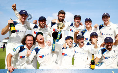 Yorkshire players celebrate with the County Championship Trophy after beating Nottinghamshire to secure the league during the fourth day of the LV County Championship at Trent Bridge in Nottingham on Friday