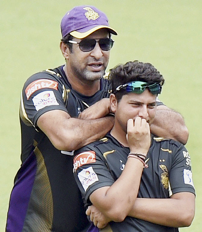KKR captain Gautam Gambhir with Morne Morkel and bowling coach Wasim Akram during a practice session at Eden Garden in Kolkata on Tuesday
