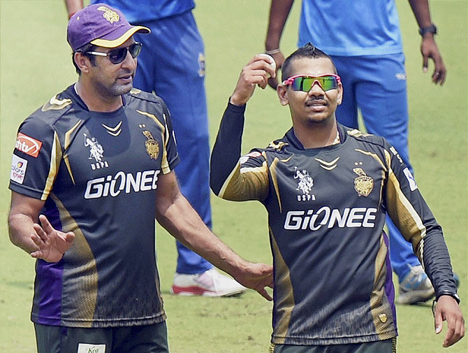 KKR player Sunil Narine and bowling coach Wasim Akram during a practice session at Eden Garden in Kolkata on Tuesday