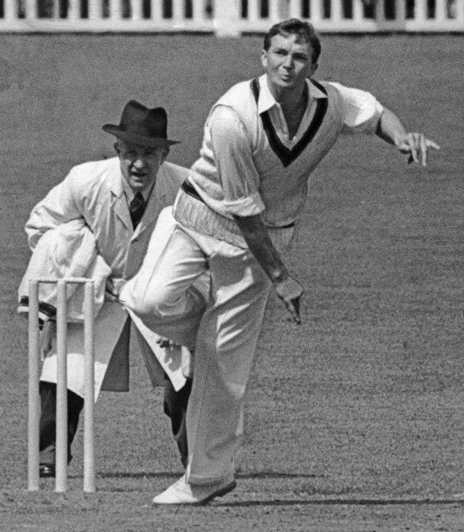 Australian cricketer and team captain Richie Benaud bowls