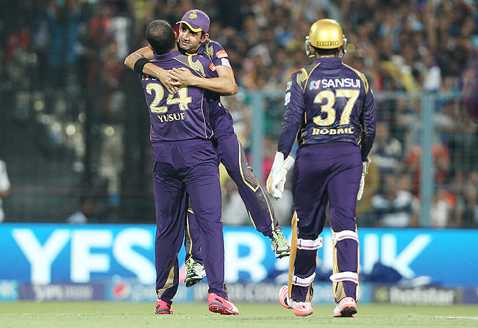 Kolkata Knight Riders' Yusuf Pathan celebrates with captain Gautam Gambhir after dismissing Royal Challengers Bangalore's Mandeep Singh