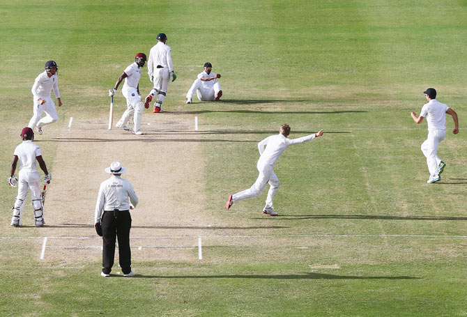 Joe Root (2nd from right ) begins his celebrations after claiming the wicket of Darren Bravo, caught by Chris Jordan at first slip